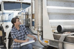 woman-inspecting-flatbed-truck