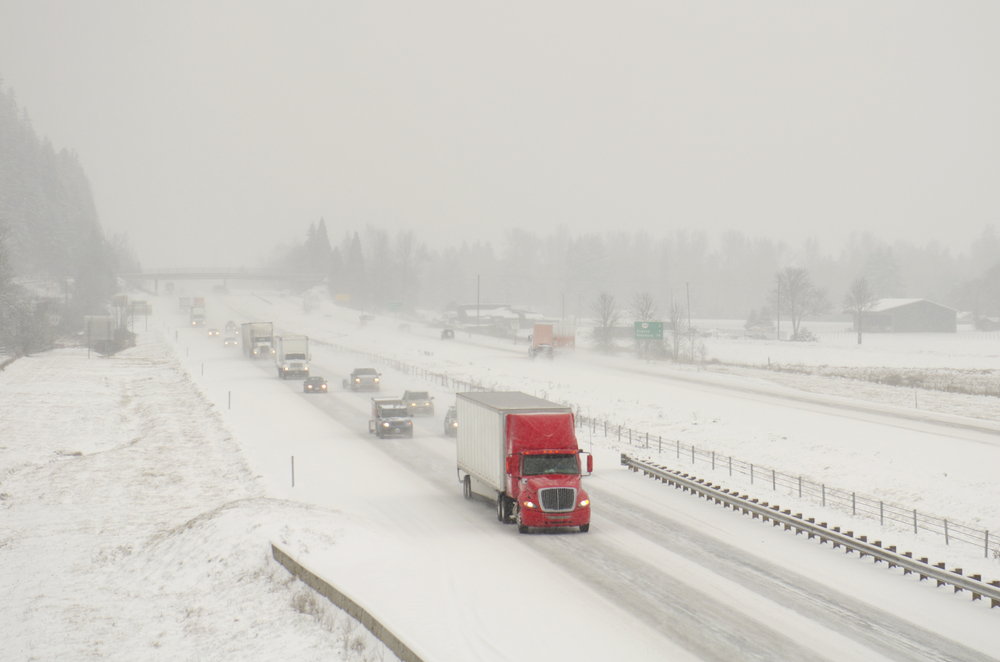 semi-truck-traffic-on-interstate-5-during-a-winter-snow-and-freezing-rain-storm