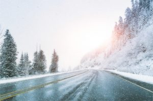 scenic-view-of-empty-road-with-snow-covered-landscape-while-snowing-in-winter-season