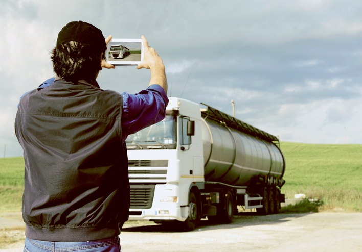 Truck driver taking a photo